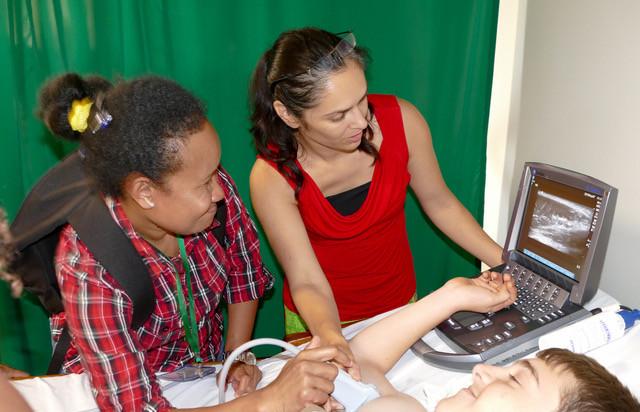 Dr Yasmin Endlich scans using a SonoSite M-Turbo ultrasound machine