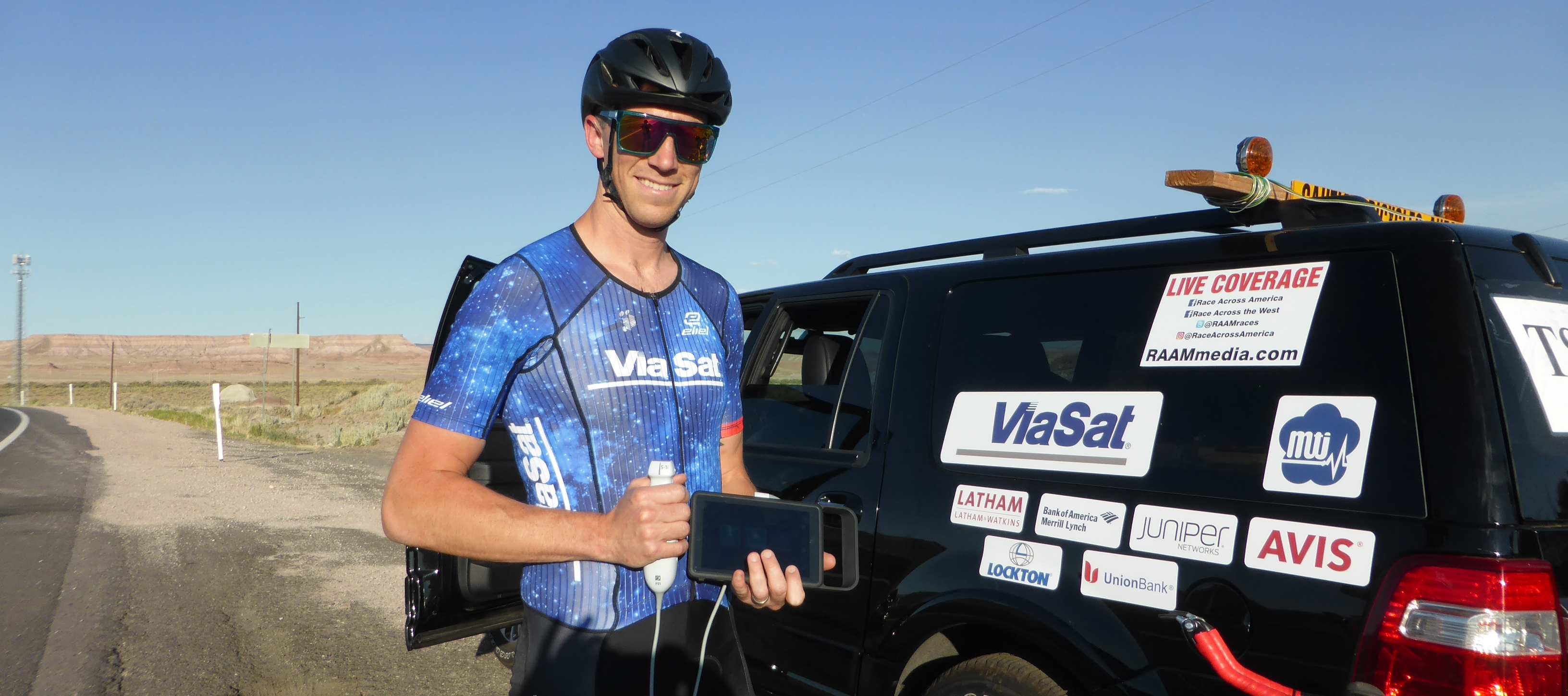 SonoSite iViz Ultrasound Machine Held by Bicyclist at Race Across America Bike Race