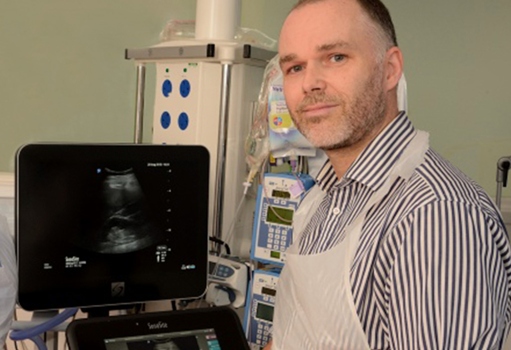 Dr. Justin Kirk-Bayley with a Sonosite ultrasound machine