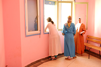 3 females wait inside Moroccan medical clinic