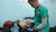Dr. Jesus Casado performing an abdominal ultrasound scan on a patient in Nepal.